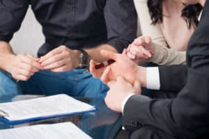 Photo of an attorney signing patients from an auto accident case.